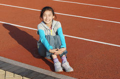 Chinese girl. The chinese little girl in the stadium royalty free stock photo