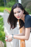 Chinese girl. A chinese girl portrait on a green garden background royalty free stock image