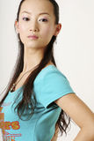 Chinese girl. Modern Chinese girl in blue T-shirt Stock Photos