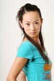 Chinese girl. Modern Chinese girl in blue T-shirt stock photo