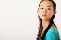 Chinese girl. Modern Chinese girl in blue T-shirt Royalty Free Stock Photo