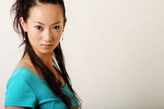Chinese girl. Modern Chinese girl in blue T-shirt Royalty Free Stock Photography