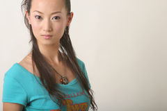 Chinese girl. Modern Chinese girl in blue T-shirt Royalty Free Stock Photos