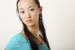 Chinese girl. Modern Chinese girl in blue T-shirt royalty free stock images