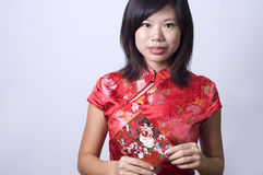 Chinese girl. Photo of chinese girl in cheong sam royalty free stock images
