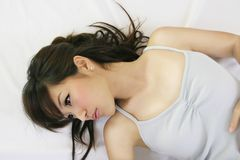 Chinese girl. Pretty chinese girl lying down relax royalty free stock images