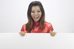 Chinese girl. Looking happy with a blank board royalty free stock images