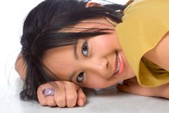 Chinese girl. Lying On the floor Stock Images