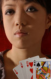 Chinese girl. Young chinese girl is playing card royalty free stock images