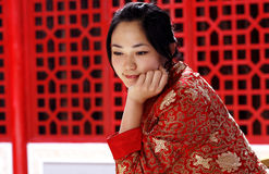 Chinese girl. A chinese girl in traditional dress Stock Photography