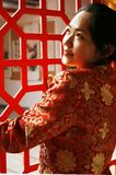 Chinese girl. In the ancient window Royalty Free Stock Image