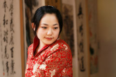 Chinese girl. One in traditional dress Chinese girl in watch China calligraphy exhibit Stock Photography
