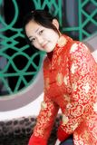 A Chinese girl. In traditional dress is before the ancient building Stock Image