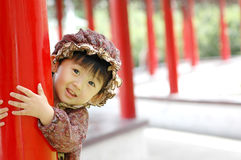 Chinese girl. Holding red pillars.In the afternoon I taken this picture Stock Images