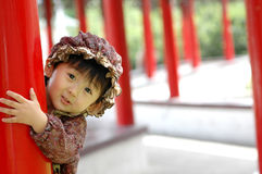 Chinese girl. Holding red pillars! Very lovely Royalty Free Stock Photo