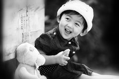 Chinese girl. The Chinese girl looking back with the toy. This black-and-white photograph was taken in her 26 months Royalty Free Stock Photo