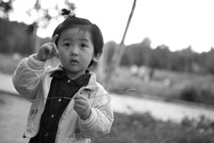 Chinese girl. The Chinese girl looking back with the toy. This black-and-white photograph was taken in her 27 months Stock Image