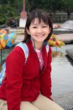 Chinese Girl. A sweet-looking young asian woman in the park stock photos