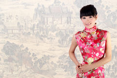 Chinese girl. A Chinese girl in traditional dress on the Chinese old painting background Royalty Free Stock Photo