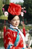Chinese girl in ancient dress. A beautiful girl in Chinese ancient dress is in the royal garden Royalty Free Stock Photography
