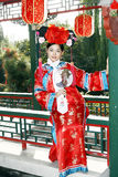 Chinese girl in ancient dress. A girl in Chinese ancient dress stands in the attic in the royal garden Stock Photo