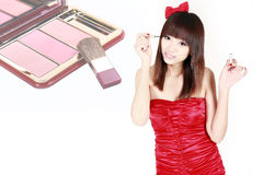 Chinese girl applying make-up Stock Photo