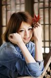 Chinese girl in Autumn Stock Photo