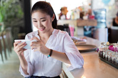 Chinese girl in the bar bar counter Royalty Free Stock Images