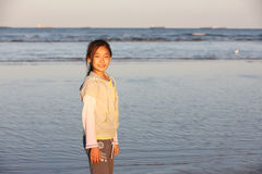 Chinese girl on the beach royalty free stock photography