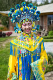Chinese girl. Beautiful chinese girl in traditional chinese dress with long sleeves and hat standing outdoor Royalty Free Stock Photos
