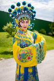 Chinese girl. Beautiful chinese girl in traditional chinese dress with long sleeves and hat standing outdoor Stock Photo