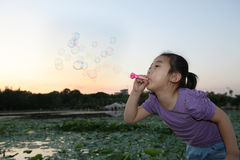 Chinese girl Blowing bubbles Stock Photography