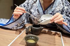 Tea art of China,make tea. A Chinese girl in blue hanfu dress is performing tea art. China has history of tea culture for more than one thousand years.Chinese Stock Images