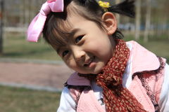 Chinese girl with bowknot. The Chinese girl looking at the camera lens Royalty Free Stock Images