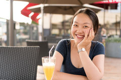 Chinese girl in cafe Stock Images