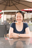 Chinese girl in cafe Royalty Free Stock Image