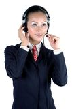 Chinese girl - call center. Charming Chinese girl, wearing suit, kind smile, working in callcenter Stock Images