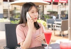 Chinese girl calling in cafe royalty free stock images