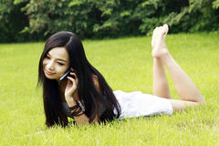 Chinese girl calling by phone Stock Image