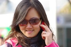 Chinese girl calling phone Royalty Free Stock Image