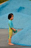 Chinese girl child plays with water in Singapore park Stock Photo