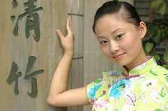 Chinese girl with Chinese signs Royalty Free Stock Photography