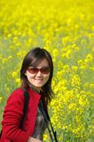 Chinese girl in cole flowers Stock Photo