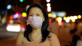 chinese girl cover her face with mask at night stock video footage