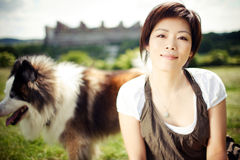 Chinese girl with a dog royalty free stock images