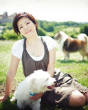 Chinese girl with a dog royalty free stock photos