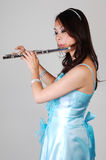 Chinese girl in dress with flute. Royalty Free Stock Photo