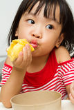 Chinese Girl Eating Durian Stock Photo