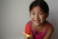 Chinese girl eating ice pop Stock Photo