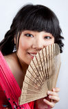 Chinese girl with a fan Stock Photo